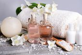 Spa composition with jasmine flowers on table on grey background