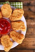 Chicken nuggets with sauce on table close-up