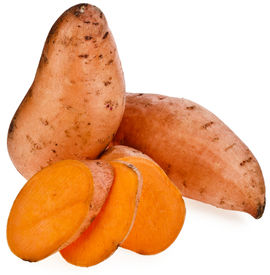 stock photo of solanum tuberosum  - Sweet potato with slices isolated on white background - JPG