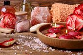 image of unity candle  - Spa concept with roses pink salt and candles that float in a wooden bowl with water - JPG