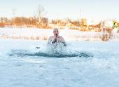 man swimming cold water