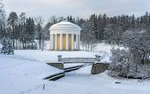 image of covered bridge  - Winter park with classical rotunda and bridge over frozen and snow - JPG