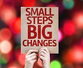 Small Steps Big Changes card with colorful background with defocused lights