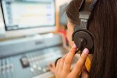 stock photo of studio  - University student mixing audio in a studio of a radio - JPG
