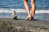 Pile Of Stones And Female Legs
