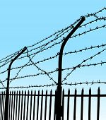 image of stockade  - vector silhouette of barbed wire fence on blue background - JPG