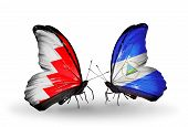 Two Butterflies With Flags On Wings As Symbol Of Relations Bahrain And Nicaragua