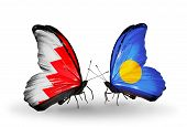 Two Butterflies With Flags On Wings As Symbol Of Relations Bahrain And Palau