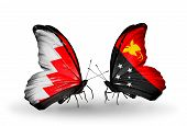foto of papua new guinea  - Two butterflies with flags on wings as symbol of relations Bahrain and Papua New Guinea - JPG