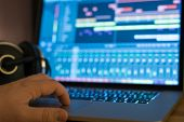 stock photo of workstation  - A user controlling digital audio workstation - JPG