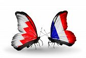 Two Butterflies With Flags On Wings As Symbol Of Relations Bahrain And France