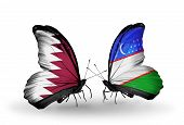 Two Butterflies With Flags On Wings As Symbol Of Relations Qatar And Uzbekistan
