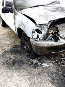 picture of wrecking  - White pickup truck burned out and wrecked on roadside - JPG