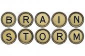 brainstorm word in old round typewriter keys isolated on white