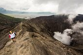 picture of bromo  - Hikers walking around the rim of Mount Bromo active volcano in Java Indonesia - JPG