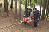 Training rescue injured people in difficult terrain at the da
