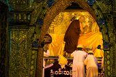 Myanmar senior monk washing Mahamuni Buddha image