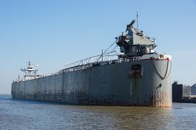stock photo of coal barge  - A large bulk carrier barge used to transport coal - JPG