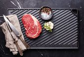image of ribeye steak  - Raw fresh Blank Angus Steak Ribeye on cast iron grill surface on marble background - JPG