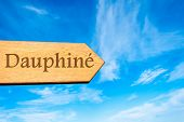 stock photo of dauphin  - Wooden arrow sign pointing destination Dauphine - JPG