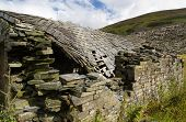 image of derelict  - Derelict stone building collapsing roof Snowdonia Wales United Kingdom - JPG