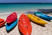 stock photo of kayak  - Colorful fiberglass kayaks tethered to a dock as seen from above - JPG