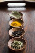 stock photo of bay leaf  - Dry herb served in wooden plate rosemary bay leaf black pepper turmeric - JPG