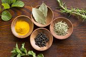 picture of flesh  - Dry herb served in wooden plate rosemary bay leaf black pepper turmeric flesh mint rosemary - JPG