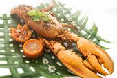 foto of lobster tail  - Baked lobster with cheese and spicy sauce served on banana leaves - JPG