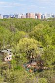 image of house woods  - above view of kindergarten in green woods and city in sunny spring day - JPG