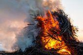 pic of bonfire  - Smoking easter bonfire set on the lake ice - JPG