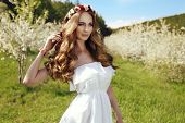 picture of headband  - fashion outdoor photo of beautiful sensual woman with long red hair and flower - JPG