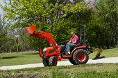 image of plow  - A older gentleman preparing to plow his garden - JPG