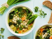 stock photo of leek  - Soup with pearl barley nettle carrot and leek - JPG