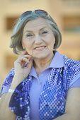 stock photo of beautiful senior woman  - Portrait of beautiful Senior woman in resort hotel - JPG