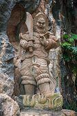 picture of evil  - Evil man sculpture Am Phu Cave Danang - JPG