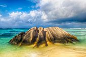 picture of long beach  - Beautifully shaped granite boulder is washed by sea at Anse Source d - JPG