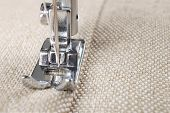 stock photo of sewing  - sewing machine makes a seam on fabric - JPG