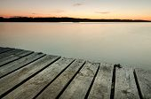 foto of pier a lake  - Small wooden pier on big lake at sunset in Ukraine - JPG