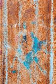 stock photo of oxidation  - abstract corroded colorful wallpaper grunge background iron rusty artistic wall peeling paint - JPG