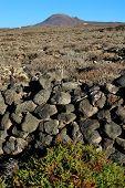 foto of volcanic  - wild volcanic landscape at Malpais de la Corona Lanzarote Island Canary Islands Spain - JPG