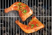 foto of bbq party  - Two BBQ Roast And Smoked Chicken Quarters On The Hot Charcoal Grill Background - JPG