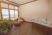 image of health center  - Jacuzzi in private room of luxury health spa with chairs and sea view - JPG