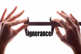 picture of ignore  - Color horizontal shot of two hands holding a caliper and measuring the word  - JPG