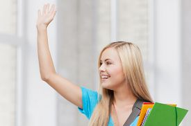 picture of waving hands  - picture of smiling student with folders waving her hand - JPG