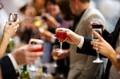 picture of new years celebration  - Holiday Event people cheering each other with champagne and wine - JPG