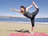 Bikram Yoga Dandayamana Dhanurasana Pose At Beach