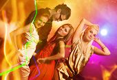 happy people dancing in the night club