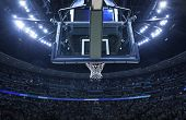 Brightly lit Basketball backboard in a large sports arena. poster