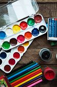 Постер, плакат: Art of Painting Paint buckets on wood background Different paint colors painting on wooden backgro